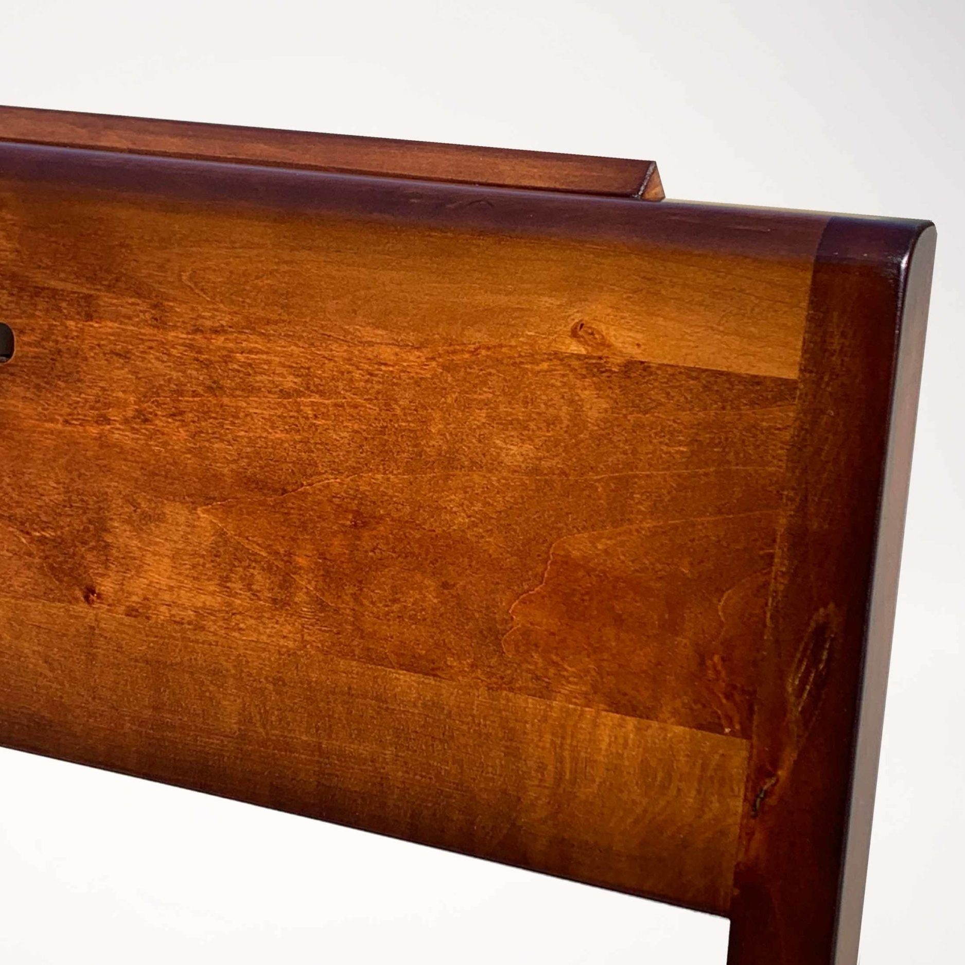 Detail of alder wood at stackable wooden church chair ZOE.