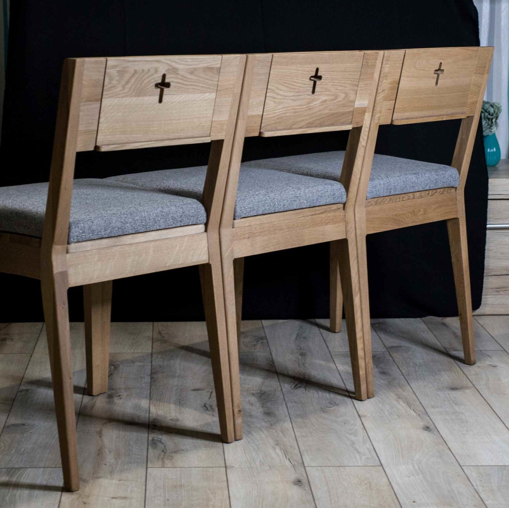 ZOE church chair linked into the wooden pew
